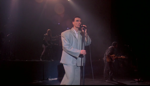 """Byrne in his iconic big suit. (Screenshot from """"Stop Making Sense."""")"""
