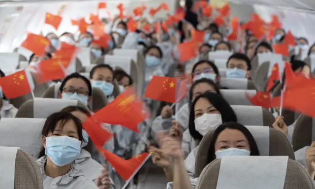 A plane departs from Wuhan carrying medical professionals home to Yunnan Province, who had come to help doctors in Wuhan manage coronavirus cases.  (https://www.theguardian.com/world/2020/mar/19/china-positions-itself-as-a-leader-in-tackling-the-coronavirus)
