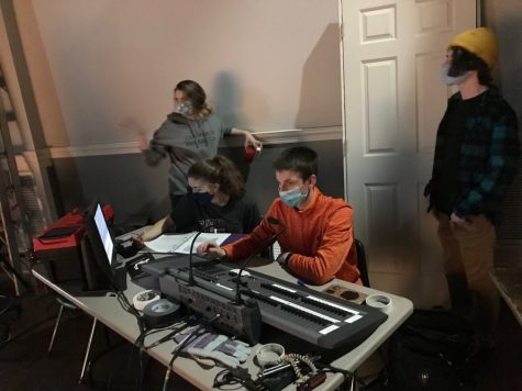 """Director Ella Sanfilippo (junior) and her stage manager Luke Miller (junior) design and program light cues for play """"Who Killed Delia Emsworth."""" (Joe Jackson/Sewickley Academy)"""